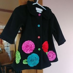 Black peacoat w colorful accents